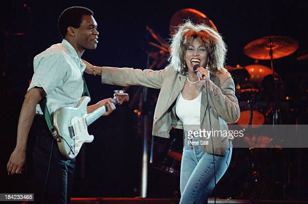 American singer Tina Turner on stage with guitarist Robert Cray during a concert on her Break Every Rule Tour at Wembley Arena London 11th June 1987...