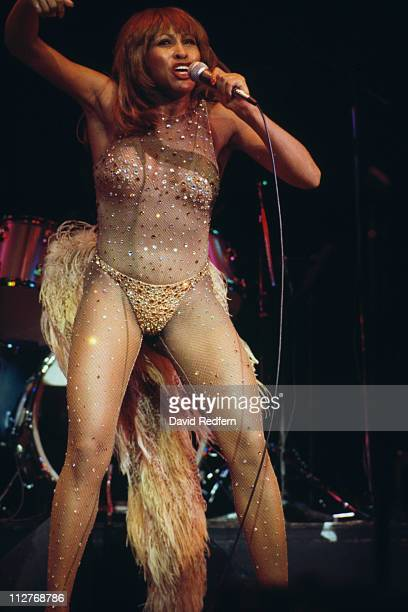 Tina Turner US singer singing into a microphone during a live concert performance circa 1980