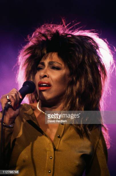 Tina Turner US singer singing into a microphone during a live concert performance at Wembley Arena London England Great Britain in June 1987