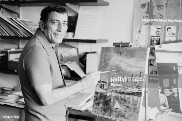 American singer Tony Bennett painting a city landscape UK 11th June 1971