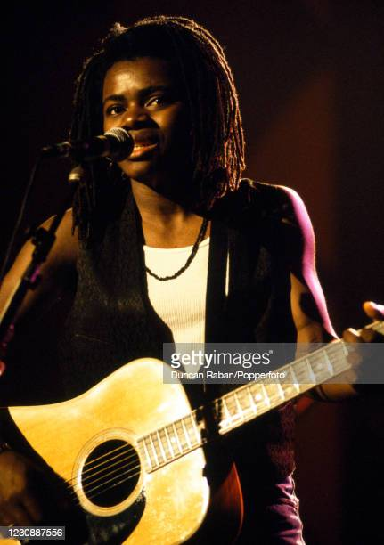 American singer Tracy Chapman performing on stage, circa 1990.