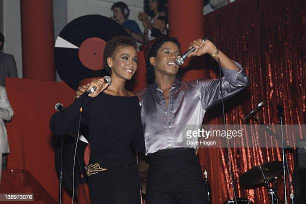American singer Whitney Houston performs with Jermaine Jackson at The Limelight in New York City 1st July 1984