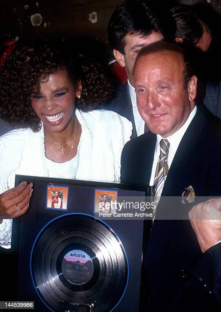 American singer Whitney Houston with President of Arista Records Clive Davis at an event to celebrate Whitney's debut album 'Whitney Houston'...