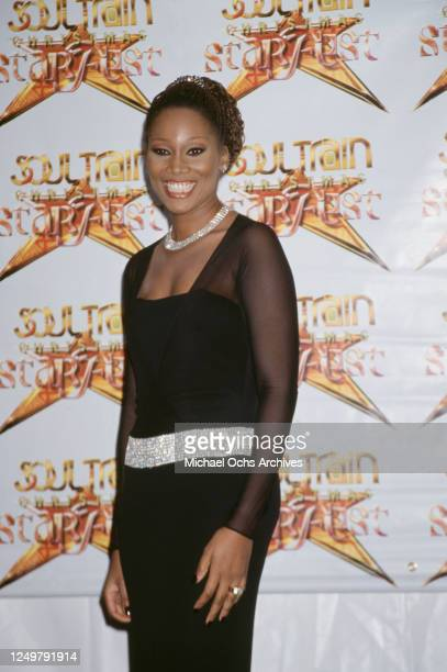American singer Yolanda Adams, wearing a black dress with chiffon sleeves, attends the 2nd Annual Soul Train Christmas Starfest, held at the Santa...