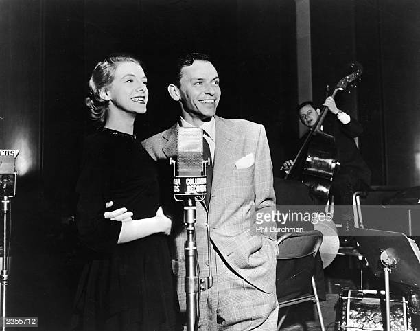 American singers and actors Rosemary Clooney and Frank Sinatra pose together during a recording session for the song 'Cherry Pies Ought to Be You'...