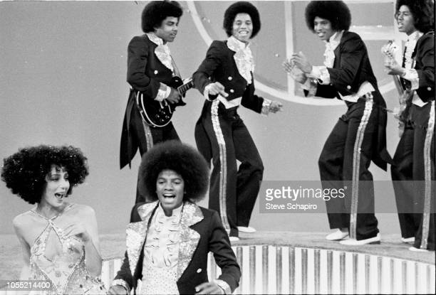 American singers Cher and Michael Jackson , along with members of the Jackson 5, perform on an episode of the former's television variety show...