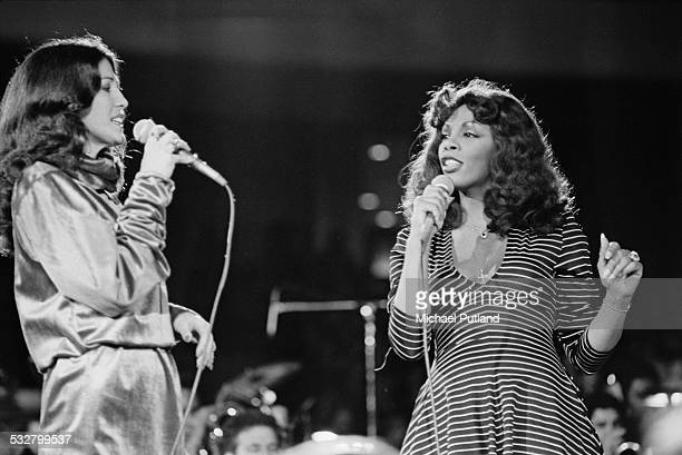 American singers Rita Coolidge and Donna Summer performing a duet at 'The Music for UNICEF Concert A Gift of Song' benefit concert held at the United...