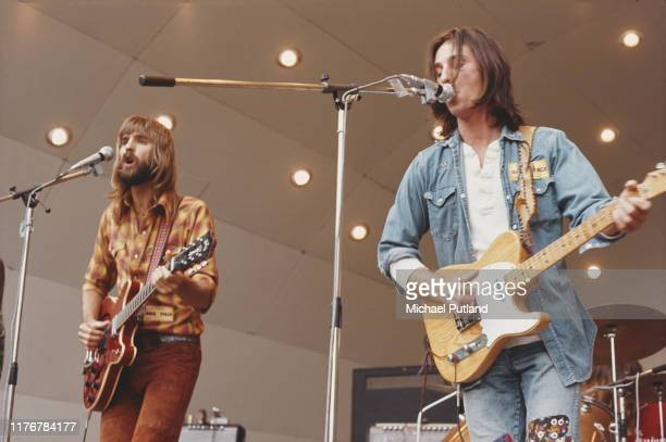 American singers songwriters and musicians Kenny Loggins and Jim Messina of Loggins and Messina perform together at the Crystal Palace Garden Party...