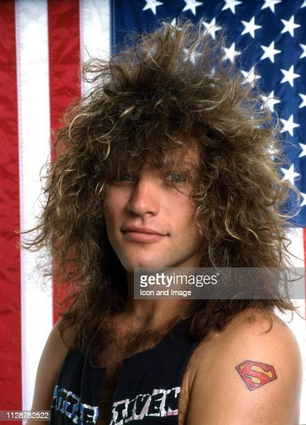 American singer-songwriter, actor and namesake of the rock band Bon Jovi poses for a portrait in front of the American flag, June in Detroit, MI.