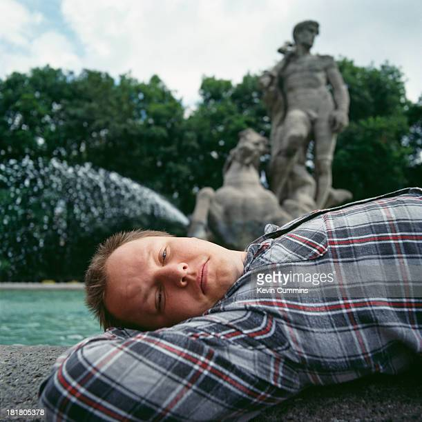 American singersongwriter and guitarist Black Francis of American rock group The Pixies posing by the Wittelsbach Fountain in Munich 1990