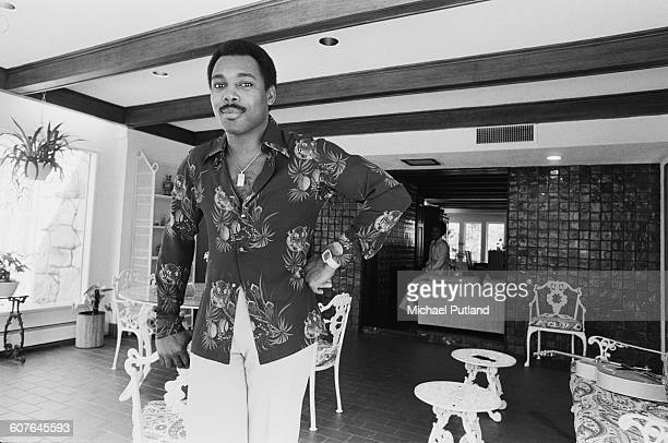 American singersongwriter and guitarist George Benson at his home USA 5th September 1977 In the background is his wife Johnnie
