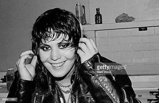 American singersongwriter and guitarist Joan Jett wearing headphones backstage New York 1981