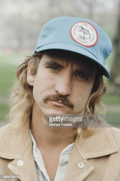 American singersongwriter and guitarist Joe Walsh of rock band Eagles posed wearing a baseball cap circa 1975