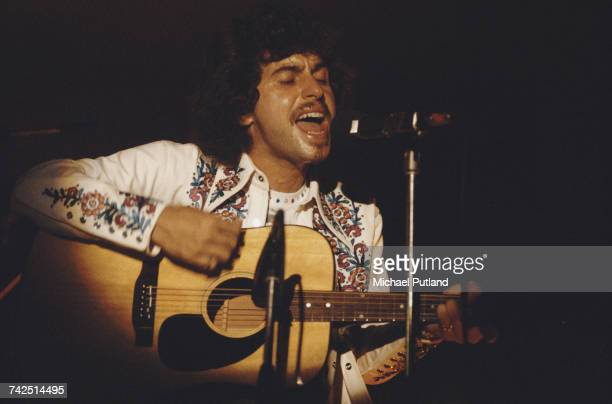 American singersongwriter and guitarist Johnny Rivers performs live playing an acoustic guitar on stage in London on 11th September 1974