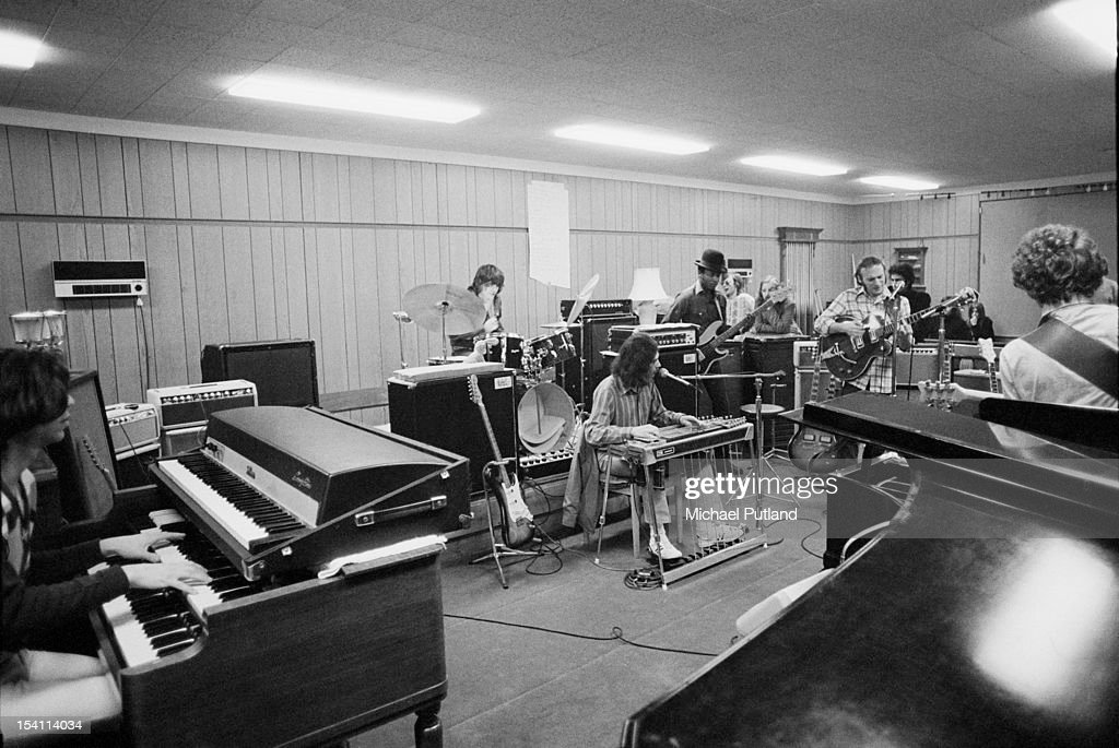 American singer-songwriter and guitarist Stephen Stills (in plaid shirt, right) rehearsing with his band Manassas at his home in Elstead, Surrey, 4th March 1972.