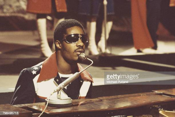 American singer-songwriter and keyboard player Stevie Wonder performs on a television show in London, circa 1974.