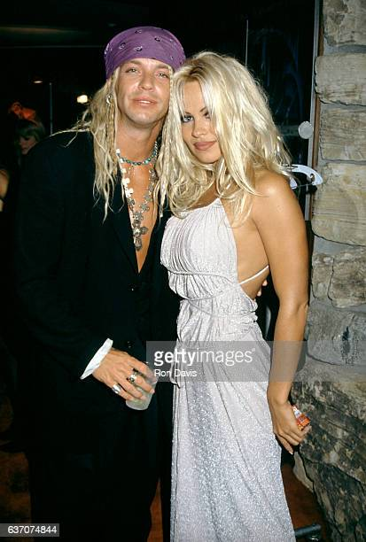 American singersongwriter and musician Bret Michaels and CanadianAmerican actress and model Pamela Anderson arrive for The Hoppening to benefit AIDS...