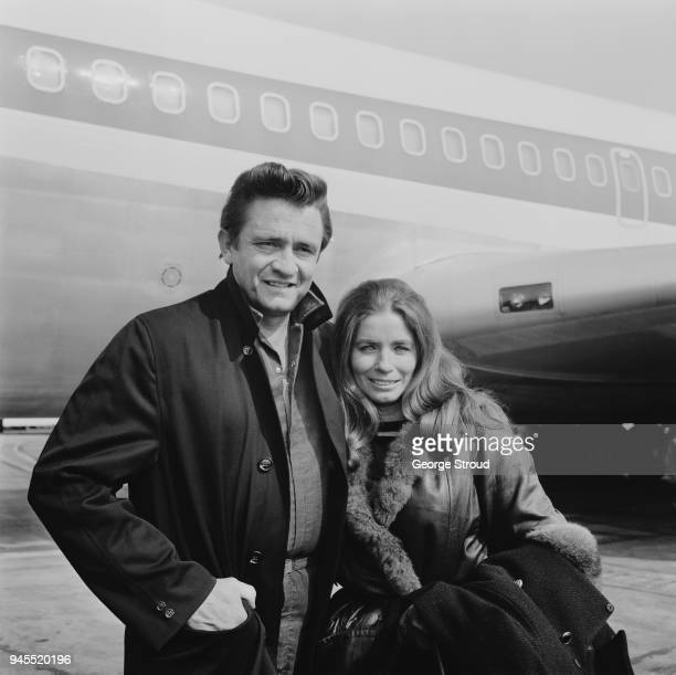 American singersongwriter and musician Johnny Cash with his wife American singer and actress June Carter at Heathrow Airport UK 3rd May 1968