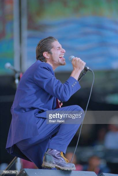 American singersongwriter and musician Perry Farrell performs live on stage with Porno for Pyros at the Woodstock '94 festival at Winston Farm in...