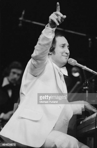 American singersongwriter and pianist Neil Sedaka performing with an orchestra February 1974