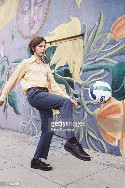 American singersongwriter Beck kicking a football Los Angeles May 1996