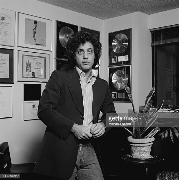 American singersongwriter Billy Joel at home in front of gold discs New York City 25th January 1978