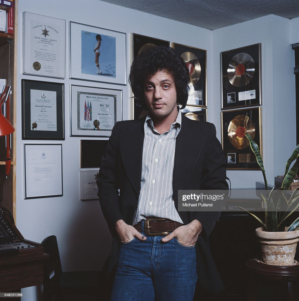 American singer-songwriter Billy Joel, at home in front of some of his gold discs, New York City, 25th January 1978. (Photo by Michael Putland/Getty Images