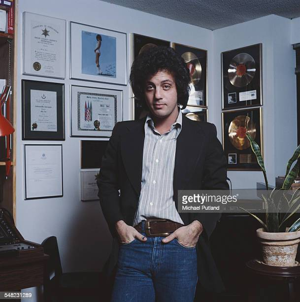 American singersongwriter Billy Joel at home in front of some of his gold discs New York City 25th January 1978 Photo by Michael Putland/Getty Images