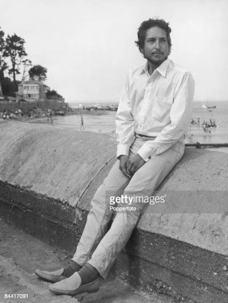 American singer-songwriter Bob Dylan by the sea on the Isle of Wight, where he will be performing at the Isle of Wight Festival, August 1969.