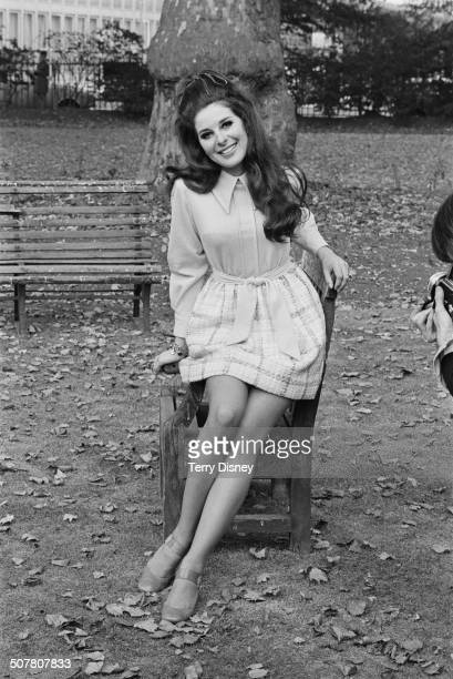 American singersongwriter Bobbie Gentry poses on a park bench 13th October 1969
