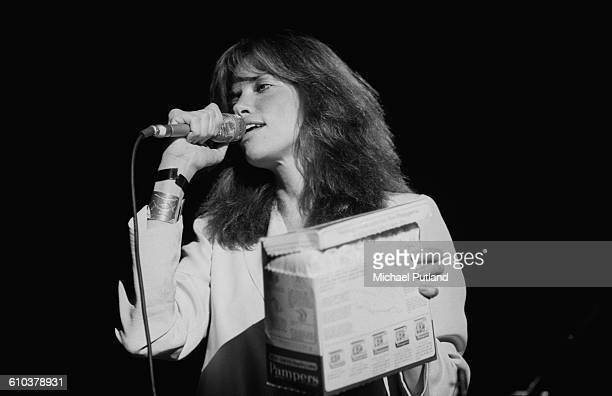 American singersongwriter Carly Simon holding a box of disposable nappies as she sings at Villanova University near Philadelphia Pennsylvania USA...