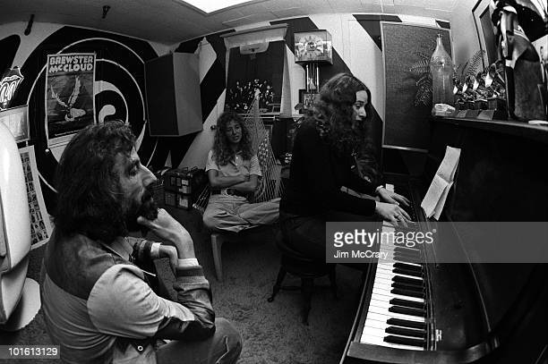 American singersongwriter Carole King plays the piano to recoord producer Lou Adler and her cowriter Toni Stern in Lou Adler's office in March 1971...