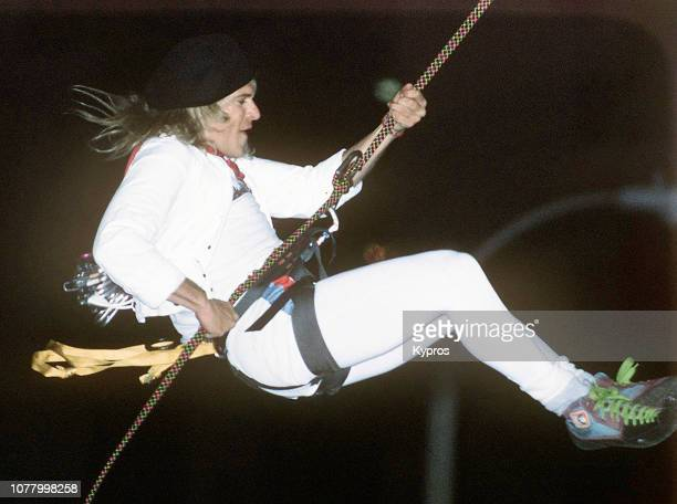 American singer-songwriter David Lee Roth climbing at the 'David Lee Roth At Tower Records' event at Tower Records in Hollywood, California, US, 21st...