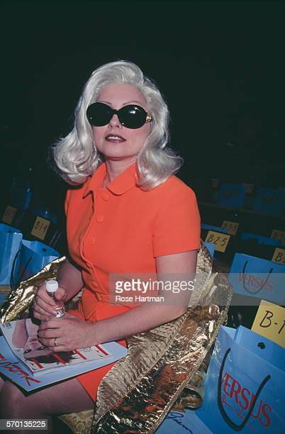 American singer-songwriter Debbie Harry attends the Versus 1996 fashion show, USA, circa 1996.