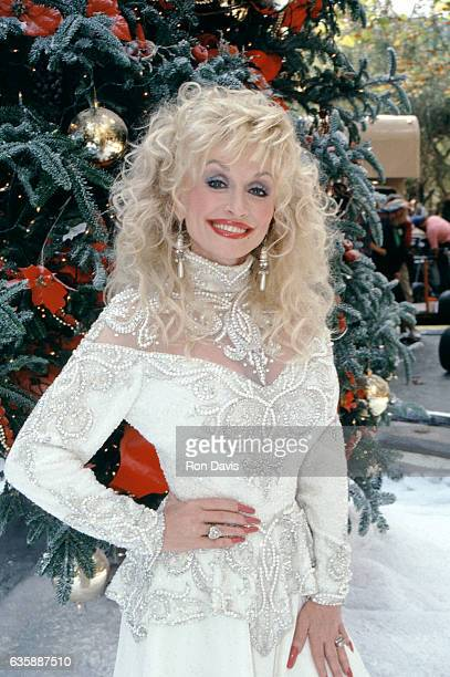 American singersongwriter Dolly Parton poses for a portrait in front of a Christmas Tree circa 1992 in Lake Tahoe California