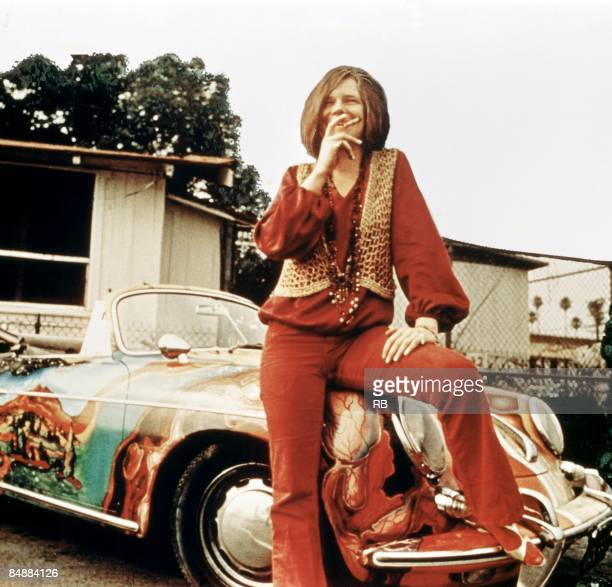 American singer-songwriter Janis Joplin with her 1965 Porsche 356C Cabriolet, circa 1969. The car features a psychedelic paint job by Joplin's...