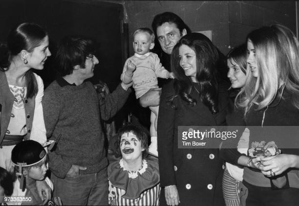 American singersongwriter Johnny Cash and family meet actor Dustin Hoffman and his wife Anne Byrne at the Ringling Brothers And Barnum Bailey Circus...