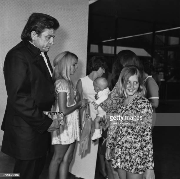 American singersongwriter Johnny Cash arrives in Hollywood with his stepdaughters Carlene Carter and Rosie Nix Adams July 1970 Behind Rosie her...