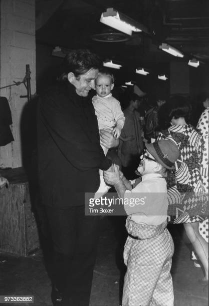 American singersongwriter Johnny Cash shakes hands with a clown at the Ringling Brothers And Barnum Bailey Circus in Madison Square New York May 1971...