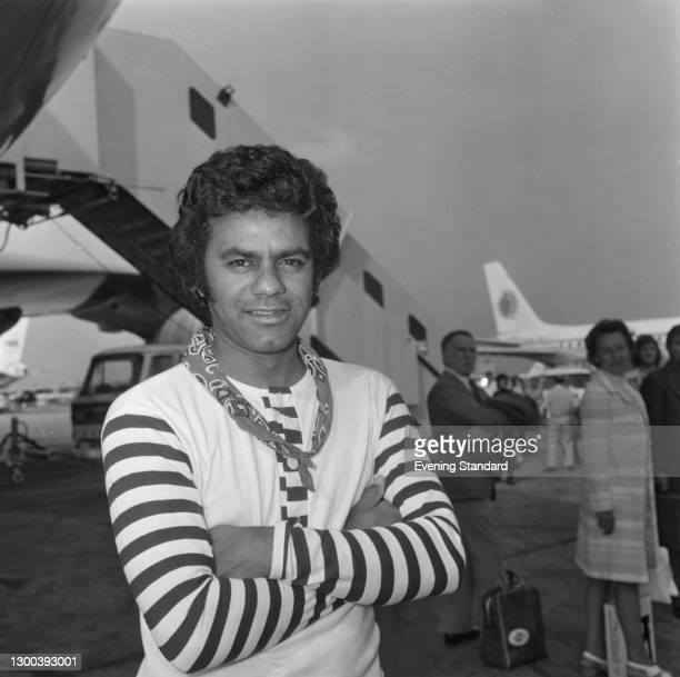 American singer-songwriter Johnny Mathis at Heathrow Airport in London, UK, 19th August 1972.