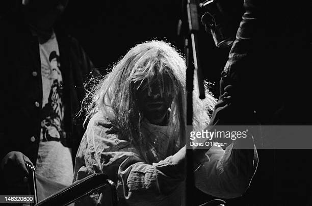 American singer-songwriter Kurt Cobain takes to the stage in a wheelchair and wearing a wig at the start of Nirvana's headline concert at the Reading...