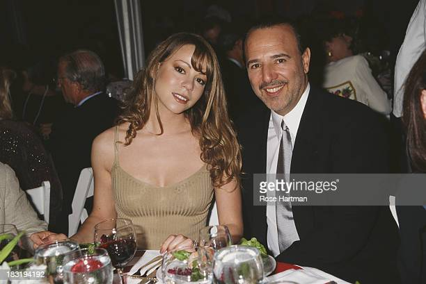 American singersongwriter Mariah Carey and husband American music executive Tommy Mottola attend the 'Salute to American Heroes Gala' 1995