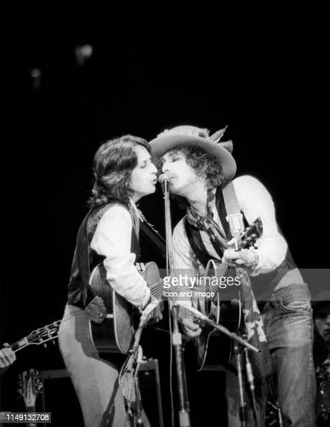 American singer-songwriter, musician and activist, Joan Baez, and American singer-songwriter, multi-instrumentalist and author, Bob Dylan, perform in...