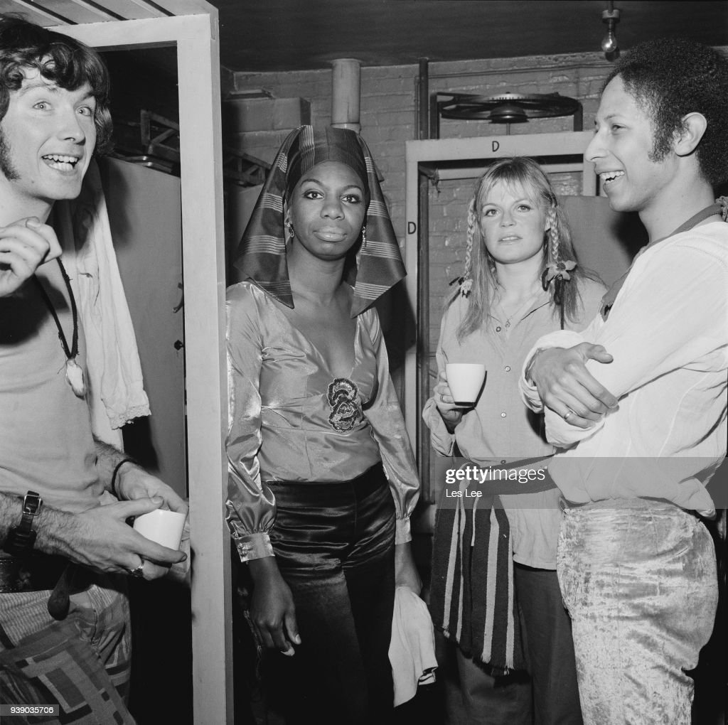 American singer-songwriter, musician and activist Nina Simone (133 - 2003) backstage with the cast of rock musical 'Hair', Uk, 4th December 1968.