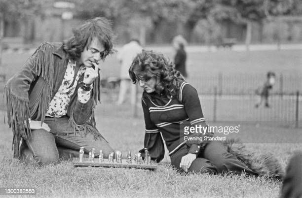 American singer-songwriter Neil Diamond plays chess in Kensington Gardens, London, with fan Joy Anderson , who presented him with the set on behalf...