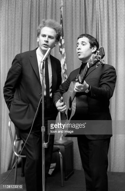 American singersongwriter Paul Simon and American singer Art Garfunkel together as folkrock duo Simon Garfunkel appear for a performance on the...