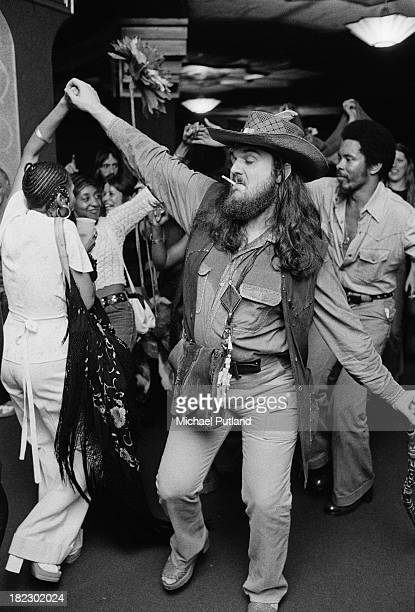 American singer-songwriter, pianist and guitarist, Dr. John dancing backstage at one of his concerts in London, 3rd July 1973.
