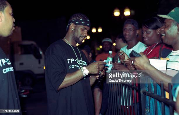 American singersongwriter R Kelly signs autographs for fans on the set of his video shoot for the single 'Bad Man' on Wabash Avenue in Chicago...