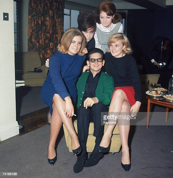 American singersongwriter Roy Orbison in London with a group of female fans circa 1965
