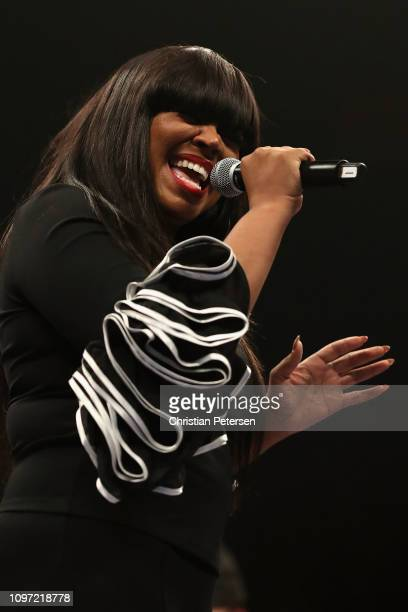 American singer–songwriter Shanice peforms the national anthem before the WBA welterweight championship between Manny Pacquiao and Adrien Broner at...